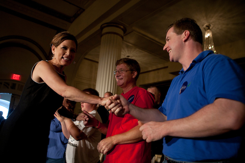 Republican presidential hopeful Michele Bachmann shakes hands with audience members during a campaign stop on Sunday, July 24, 2011 in Davenport, IA.