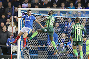 Karleigh Osborne of AFC Wimbledon and Marc McNully jump for the ball during the Sky Bet League 2 match between Portsmouth and AFC Wimbledon at Fratton Park, Portsmouth, England on 15 November 2015. Photo by Stuart Butcher.