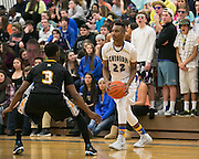 Shandare Figgins of Webster Schroeder looks for a teammate during a game against Greece Athena on Friday, January 23, 2015.