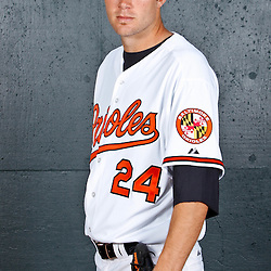 February 26, 2011; Sarasota, FL, USA; Baltimore Orioles starting pitcher Chris Tillman (24) poses during photo day at Ed Smith Stadium.  Mandatory Credit: Derick E. Hingle