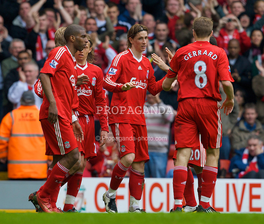 LIVERPOOL, ENGLAND - Sunday, May 4, 2008: Liverpool's Fernando Torres celebrates scoring the opening goal, his 23rd of the season, to equal the record of most goals scores in a debut season by a foreign player, with captain Steven Gerrard MBE against Manchester City  during the Premiership match at Anfield. (Photo by David Rawcliffe/Propaganda)