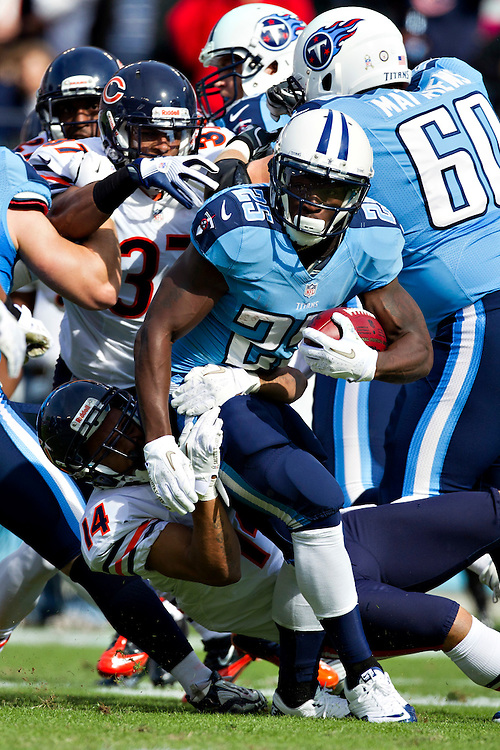 NASHVILLE, TN - NOVEMBER 4:  Darius Reynaud #25 of the Tennessee Titans is tackled by Eric Weems #14 of the Chicago Bears at LP Field on November 4, 2012 in Nashville, Tennessee.  The Bears defeated the Titans 51-20.  (Photo by Wesley Hitt/Getty Images) *** Local Caption *** Darius Reynaud; Eric Weems