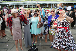 © Licensed to London News Pictures. 08/04/2016. Liverpool, UK. A group of ladies celebrate winning on Ladies Day at the Grand National 2016 at Aintree Racecourse near Liverpool. The race, which was first run in 1839, is the most valuable jump race in Europe. Photo credit : Ian Hinchliffe/LNP