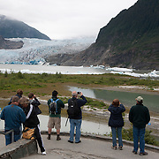 Passengers from cruise ships visit Mendenhall Glacier is a glacier about 12 miles (19 km) long located in Mendenhall Valley, about 12 miles (19 km) from downtown Juneau, Alaska. The glacier and surrounding landscape is protected as the 5,815-acre Mendenhall Glacier Recreation Area.  Photography Jose More