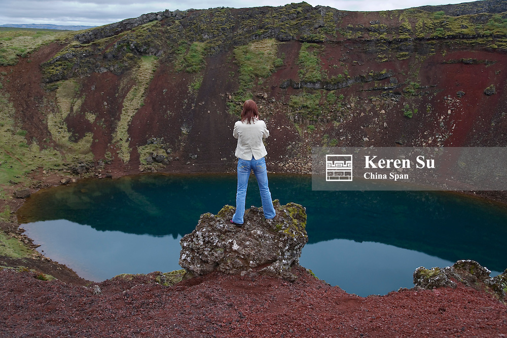 Traveler at Crater Kerio, Iceland