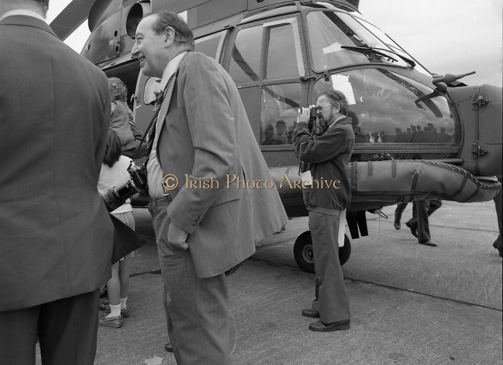 "Air Corps Takes Delivery Of Puma Helicoptor. (N86)..1981..22.07.1981..07.22.1981..22nd July 1981..The Air Corps took delivery,today, of a new French Built SA 330 J ""Puma"" Helicoptor. The ""Puma"" escorted by another Air Corps helicoptor landed at Casement Aerodrome, Baldonnell,Co Dublin...A member of the air crew is greeted by his children after landing at the base."