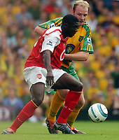 Fotball<br /> Foto: SBI/Digitalsport<br /> NORWAY ONLY<br /> <br /> Date: 28/08/2004<br /> <br /> Norwich City V Arsenal <br /> <br /> Norwich City's Gary Doherty and Arsenal's Kolo Toure