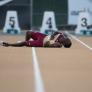 The 2014 USA Track and Field  Championships in Sacramento:The 2014 USA Track and Field  Championships in Sacramento:  Men's 100 meter dash-1st round, Dentarius Locke writhes on the ground in pain.