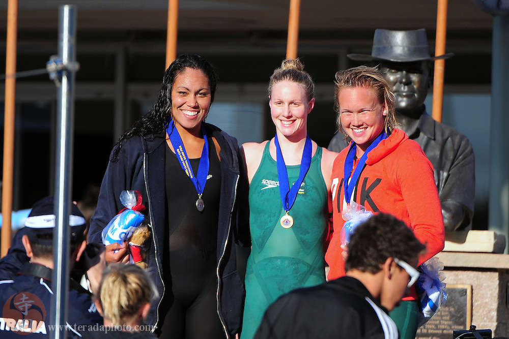 June 1, 2012; Santa Clara, CA, USA; Silver medalist Chelsea Chenault (USA), left, gold medalist Bronte Barratt (AUS), center, and bronze medalist Kylie Palmer (AUS), right, pose for a photo after receiving their medals during the women's 400-meter freestyle finals in the Santa Clara international grand prix at the George F. Haines International Swim Center.