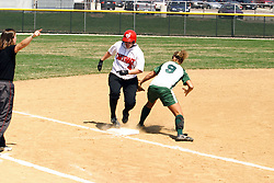 05 April 2008: Jenny Burke makes it to 3rd base when Allison Ward can't come up with the ball. The Carthage College Lady Reds lost the first game of this double header to the Titans of Illinois Wesleyan 4-1 at Illinois Wesleyan in Bloomington, IL