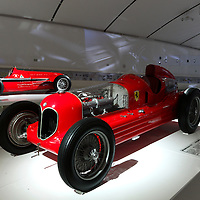 Alfa Romeo Bimotore (front) and Alfa Romeo 158 (back left) and Auto Avio Costruzioni 815 (back right) at Museo Casa Enzo Ferrari, 2014