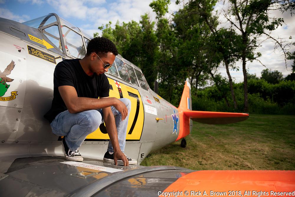 Bryan Harper - farmer, pilot - checking fuel on his Harvard.