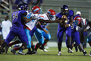 Malik Shellie of the Lincoln Tigers scrambles against the Carter Cowboys during a high school football game at Forester Stadium in Dallas, Texas on September 18, 2015. (Cooper Neill/Special Contributor)