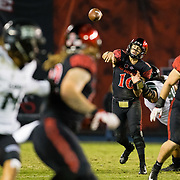 24 November 2018: San Diego State Aztecs quarterback Christian Chapman (10) is hit as he passes the ball down field for a completion in the third quarter. The Aztecs closed out the season with a 31-30 overtime loss to Hawaii at SDCCU Stadium.
