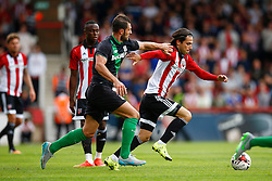 Jota of Brentford under pressure from Erik Pieters of Stoke City - Mandatory by-line: Jason Brown/JMP - Mobile 07966 386802 25/07/2015 - SPORT - FOOTBALL - Brentford, Griffin Park - Brentford v Stoke City - Pre-Season Friendly