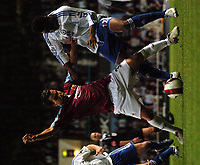 Photo: Tony Oudot.<br /> West Ham United v Chelsea. The Barclays Premiership. 18/04/2007.<br /> Carlos Tevez of West Ham tackles John Obi Mikel of Chelsea