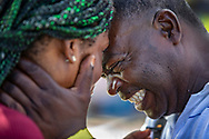 Bernard Monestime and his wife, Ordena Lauroe, embrace as they wait to be checked in to a shelter for Hurricane Dorian victims in Nassau, Bahamas on Monday, September 9, 2019.