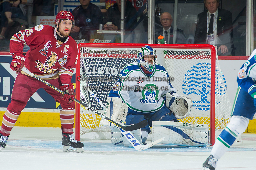 REGINA, SK - MAY 19: Jeffrey Truchon-Viel #25 of Acadie-Bathurst Titan looks for the pass in front of the net of Stuart Skinner #74 of Swift Current Broncos at the Brandt Centre on May 19, 2018 in Regina, Canada. (Photo by Marissa Baecker/CHL Images)
