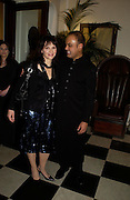 Juliette Binoche and Dr. Joshi. Book launch for Dr. Joshi's Holistic Dett. The Arts Club, 40 Dover st. London. 26 May 2005. ONE TIME USE ONLY - DO NOT ARCHIVE  © Copyright Photograph by Dafydd Jones 66 Stockwell Park Rd. London SW9 0DA Tel 020 7733 0108 www.dafjones.com