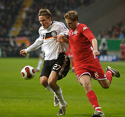 FRANKFURT, GERMANY - Wednesday, November 21, 2007: Wales' Chris Gunter and Germany's Clemens Fritz during the final UEFA Euro 2008 Qualifying Group D match at the Commerzbank Arena. (Pic by David Rawcliffe/Propaganda)