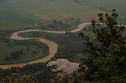 The Animas River, cloaked by heavy rainfall, meanders through the river valley north of Durango, Colorado. The river is discolored by toxic wastewater following the Gold King Mine spill August 5. This region is used for agriculture.