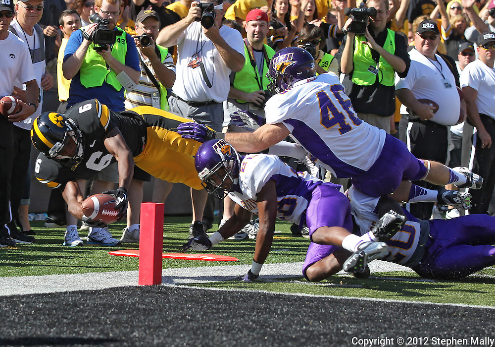 September 15 2012: Iowa Hawkeyes wide receiver Keenan Davis (6) dives for the end zone as he is pushed out of bounds by Northern Iowa Panthers defensive back J.J. Swain (28), defensive back Wilmot Wellington (20), and linebacker Jake Farley (46) during the second quarter of the NCAA football game between the Northern Iowa Panthers and the Iowa Hawkeyes at Kinnick Stadium in Iowa City, Iowa on Saturday September 15, 2012. Iowa defeated Northern Iowa 27-16.