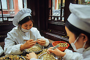 Old City, cooking traditional dumplings.