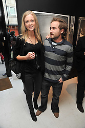 Tassos Papantoniou and Vivianne Raudsepp at a private view of Russell Young's work entitled American Envy held at Scream Gallery, 34 Bruton Street, London on 7th April 2011.