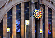 The Facade Windows And Clock Of The Cincinnati Museum Center At Union Terminal In It's Late Evening Appearance, Outside Lights Beginning to Come On, Cincinnati Ohio USA