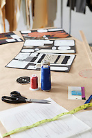 Fashion designing materials on table in design studio