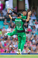 Melbourne Stars player Sandeep Lamichhane celebrates the wicket of Sydney Sixers player Moises Henriques at the Big Bash League cricket match between Sydney Sixers and Melbourne Stars at The Sydney Cricket Ground in Sydney, Australia