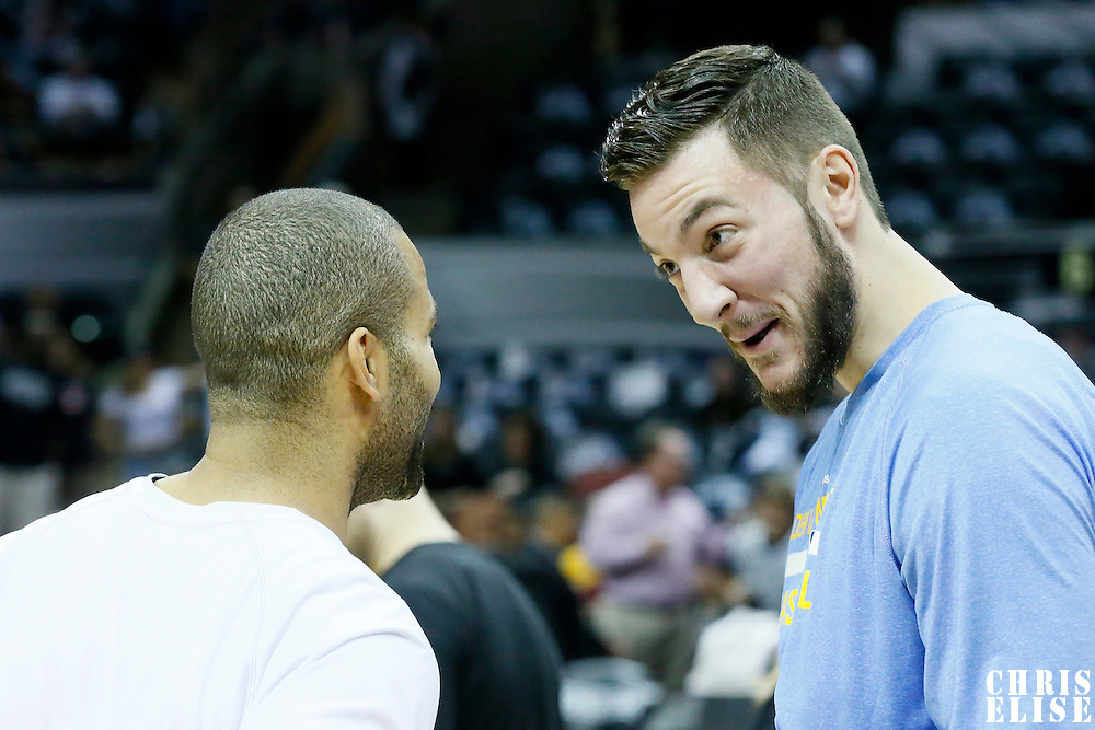 03 April 2015: Denver Nuggets forward Joffrey Lauvergne (77) talks to San Antonio Spurs guard Tony Parker (9) prior to the San Antonio Spurs 123-93 victory over the Denver Nuggets , at the AT&T Center, San Antonio, Texas, USA.