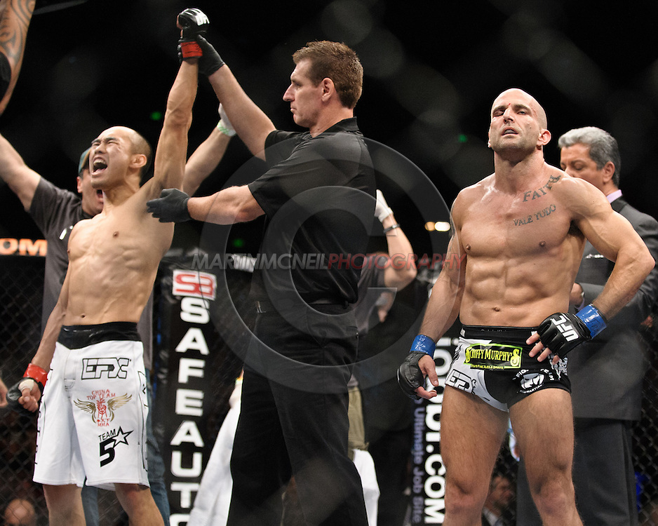 "SYDNEY, AUSTRALIA, FEBRUARY 27, 2011: Zhang Tiequan (left) celebrates his win over Jason Reinhardt during ""UFC 127: Penn vs. Fitch"" inside Acer Arena in Sydney, Australia on February 27, 2011."
