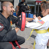 Sensei from Z-Ultimate Self Defense Paul Buenrostro works with children during the Santa Monica Chamber of Commerce's 26th Annual Health and Fitness Festival at the Third Street Promenade on Saturday, July 30, 2011.