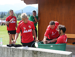 14.07.2013, Walchsee, AUT, FC Augsburg, Trainingslager, im Bild Halil ALTINTOP (FC Augsburg #7) sitzt in der Tonne mit Eiswasser nach dem Training, mit Sascha Mv&Ograve;LDERS, MOELDERS (FC Augsburg #33) und Matthias OSTRZOLEK (FC Augsburg #19) // during a trainings session of German 1st Bundesliga club FC Augsburg at their training camp in Walchsee, Austria on 2013/07/14. EXPA Pictures &copy; 2013, PhotoCredit: EXPA/ Eibner/ Klaus Rainer Krieger<br /> <br /> ***** ATTENTION - OUT OF GER *****