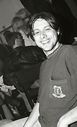 Shaun Ryder smiles for the camera backstage at a Happy Mondays gig at the Free Trade Hall in Manchester, 1989.