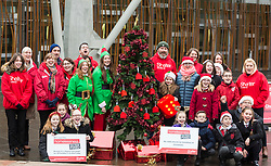 """Campaigners from Shelter Scotland raise awareness of their campaign """"Homelessness - Far From Fixed"""" outside the Scottish Parliament in Edinburgh. They are joined by carol singers from Corstorphine Primary School, a Christmas tree and a giant snakes and ladders board game - Chance Not Choice - which illustrates how life chances affect people's ability to keep a roof over their head.<br /> <br /> Pictured:"""