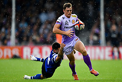 Tom Wyatt of Exeter Chiefs is challenged by Rhys Davies of Bath Rugby - Mandatory by-line: Ryan Hiscott/JMP - 21/09/2019 - RUGBY - Sandy Park - Exeter, England - Exeter Chiefs v Bath Rugby - Premiership Rugby Cup