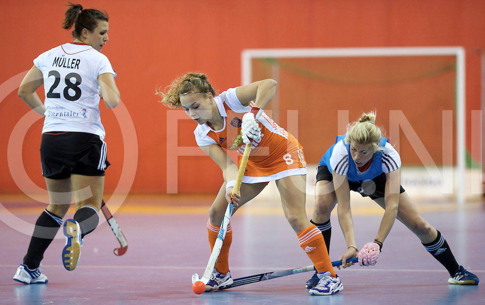 Prague - EuroHockey Indoor Championship (W) 2014<br /> 07 NED v GER (Pool B)<br /> foto: f.l.t.r.: Julia Muller, Mila MUYSELAAR and Kristina Hillmann.<br /> FFU PRESS AGENCY COPYRIGHT FRANK UIJLENBROEK