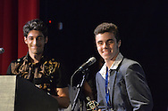 """Bellmore, New York, USA. July 21, 2016. L-R, Co-Producers Robbie Rosen, 22, and teenager James Phillips accept trophy for winning Music Video """"Chains"""" at the 19th Annual Long Island International Film Expo Awards Ceremony, LIIFE 2016, held at the historic Bellmore Movies. James Phillips was also Director, and Robbie Rosen sang the duet with Sarah Barrios. LIIFE was called one of the 25 Coolest Film Festivals in the World by MovieMaker Magazine."""