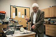 "AUBURN, AL – NOVEMBER 20, 2016: Professor Tony Overfelt examines an antique cathode ray tubes from a television set for use in an additive manufacturing experiment. In 2016, Auburn University received a grant to develop low cost additive manufacturing techniques, which would allow small businesses interested in additive manufacturing to cheaply test the method's viability for their unique production needs. By repurposing the infrastructure inside cathode ray tubes, the existing electron gun inside the tubes is harnessed for additive manufacturing. ""All the infrastructure used in the million dollar machines is right here in these tubes,"" Prorok said. ""It's more crude, and tuned to a different application, but it's there. We're trying to harness them to do something new."" Prorok believes the method has potential to become the new paradigm for how newer additive manufacturing machines are built.<br /> <br /> In much of the United States, global trade and technological innovation has failed to produce the prosperity hoped for by political and business leaders. Yet despite formidable economic challenges, some localities are flourishing. In Lee County, Ala., unemployment is below the national average despite the loss of thousands of manufacturing jobs, and the key to the county's resilience may be Auburn University, which provided a steady source of employment during recessions and helped draw new businesses to replace those that fled. CREDIT: Bob Miller for The Wall Street Journal<br /> [RESILIENT]"
