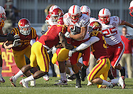 November 06 2010: Nebraska Cornhuskers running back Roy Helu Jr. (10) is hit by Iowa State Cyclones cornerback David Sims (1) and Iowa State Cyclones cornerback Michael O'Connell (37) during the first half of the NCAA football game between the Nebraska Cornhuskers and the Iowa State Cyclones at Jack Trice Stadium in Ames, Iowa on Saturday November 6, 2010. Nebraska defeated Iowa State 31-30.