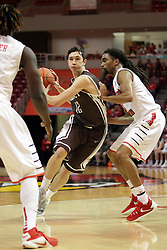 27 November 2015:  Bobby Frasco makes a cut between Quintin Brewer (2) and Tony Wills(12). Illinois State Redbirds host the Quincy Hawks at Redbird Arena in Normal Illinois (Photo by Alan Look)