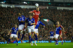 LIVERPOOL, ENGLAND - Tuesday, March 13, 2012: Liverpool's Andy Carroll in action against Everton's Sylvain Distin, captain Phil Jagielka and Marouane Fellaini during the Premiership match at Anfield. (Pic by David Rawcliffe/Propaganda)