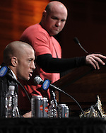 "NEW YORK, NEW YORK, MARCH 24, 2010: UFC welterweight champion Georges St. Pierre (left) fields questions from the media whilst UFC president Dana White listens during the pre-fight press conference for ""UFC 111: St. Pierre vs. Hardy"" inside Radio City Music Hall in New York City"