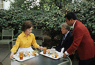 President Carter and First Lady Rosslyn Carter have lunch in a patio outside of the Oval Office in August 1977. An exclusive photograph taken on assignment for TIME.  ..Photograph by Dennis Brack bb 27