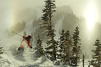 Russell Laman (age 12)  skiing fresh powder snow in Jackson Hole, Wyoming.<br />Ice crystals in the air on a sunny morning creat sun dog type bright spots in the fog.
