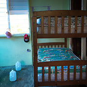 Guayama, Puerto Rico - July 6, 2018: Children's bedroom inside Pedro Ortiz's house destroyed by Hurricane Maria. His son Devin plays for the 12 and Under selection from Guayama which will compete in Little League World Series.<br /> (Angel Valentin for ESPN)