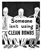 "(Dwight D Eisenhower, Nikita Khrushchev and Harold Macmillan with the placard ""Someone isn't using clean bombs"")"