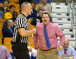 Morgantown head coach Jason White yells at a referee against Buckhannon Upshur during a first round game at the Charleston Civic Center.